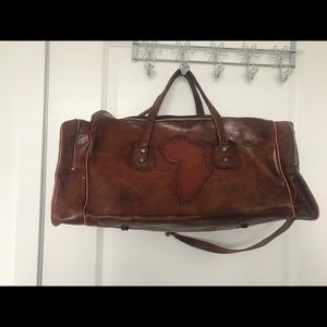 Leather bag with the map of Africa